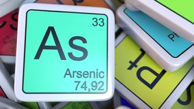 Arsenic As block on the pile of periodic table of the chemical elements blocks. Chemistry related 3D rendering. Arsenic tag on the pile of periodic table of the Stock Photos