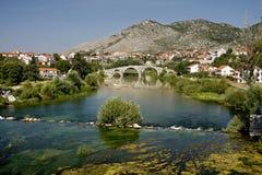 The Arslanagic Bridge, Trebinje, Bosnia. And Herzegovina. Thet bridge was taken, stone by stone, from a village seven kilometres up the river, and rebuilt in Royalty Free Stock Photo