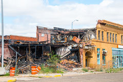 Arson Fire Burned Building. Rubble of historic small business building destroyed by arsonist royalty free stock photos