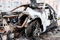 Arson fire burnt wheel car vehicle junk. Road wreck accident or arson fire burnt wheel car vehicle junk Stock Photos