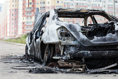 Arson fire burnt wheel car vehicle junk Royalty Free Stock Image