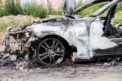 Arson fire burnt wheel car vehicle junk. Road wreck accident or arson fire burnt wheel car vehicle junk Royalty Free Stock Photos