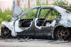 Arson fire burnt wheel car vehicle junk Royalty Free Stock Photo