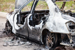 Arson fire burnt wheel car vehicle junk Stock Image