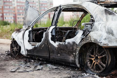 Arson fire burnt wheel car vehicle junk Stock Images