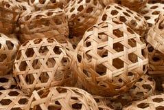 Artículo de mimbre anaranjado con el bambú Imagen de archivo