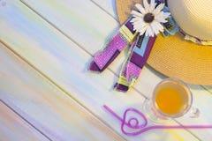 Artículos de las vacaciones en una tabla de madera coloreada Fotografía de archivo libre de regalías