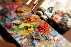 Artículos a pintar con las pinturas de aceite stock de ilustración