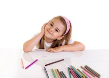 Art. Little girl drawing with crayons stock photos