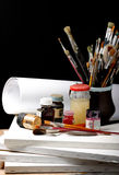 Art. Brushes well used in a Jar on black Royalty Free Stock Image