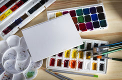 Art album, watercolor, paint brushes and pencils, on wooden boards Stock Images
