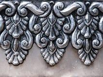 Art on aluminium wall. Thai craftmanship at temple Stock Photo