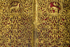 The art of ancient Thai to make a door craft. Royalty Free Stock Image