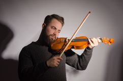 Art and artist. Young emotional man violinist fiddler playing v royalty free stock image