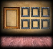 Art backdrop wooden  frames on wall Royalty Free Stock Photos