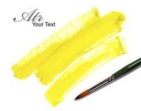 Art background. Brush and yellow paint draw Stock Image