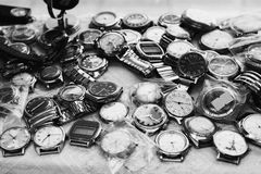Art black and white photography. Black and white art photography monochrome, many wrist watch closeup. Men`s Accessories. Men`s style. Antiques royalty free stock photos