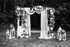Art black and white photography. Wedding decorations. Black and white art photography monochrome, beautiful wedding ceremony outdoors. Wedding arch made of cloth Royalty Free Stock Images