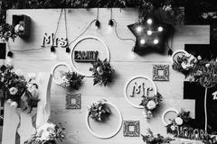 Art black and white photography. Wedding decorations. Black and white art photography monochrome, beautiful unusual wedding decor. Rustic Style. Bench, wall of stock images