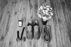 Art black and white photography. Wedding decorations. Black and white art photography monochrome, gray man`s shoes on the floor. Men`s style, fashion. Charges Stock Photos
