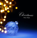 Art Blue Christmas ball and Christmas lights Stock Images