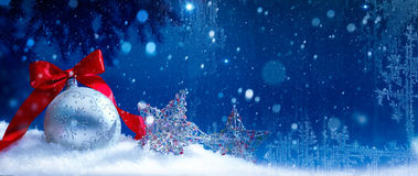 Art blue snow christmas background. Blue Christmas; Holidays background with Xmas decoration on snow royalty free stock photography