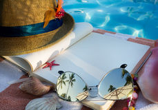 Art book and Sunglasses on the beach Stock Image