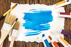 Art brush and blue watercolor painted with white paper art  on w Stock Images