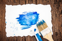 Art brush and blue watercolor painted with white paper art  on w Stock Photography