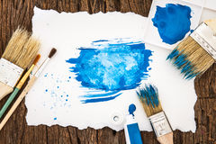 Art brush and blue watercolor painted with white paper art  on w Stock Photos