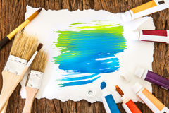 Art brush and blue yellow watercolor painted with white paper ar Royalty Free Stock Image