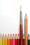Art brush and simple pencil for plotting among colour pencils. Made of a tree Royalty Free Stock Photo
