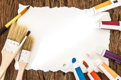 Art brush watercolor paint with white paper art  on wooden backg Royalty Free Stock Photo