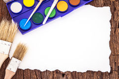 Art brush watercolor paint with white paper art on wooden backg. Round royalty free stock images