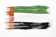 UAE flag. Art brush watercolor painting of UAE flag blown in the wind isolated on white background Stock Photo