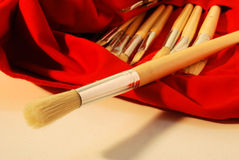 Art brushes. Set of brushes with wooden handle, on a bag of red fabric stock photos