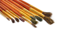 Art brushes. Different art brushes closeup over white background Royalty Free Stock Photography