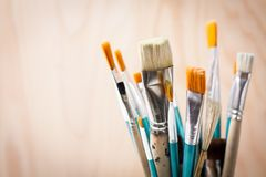 Art brushes against light warm background stock images