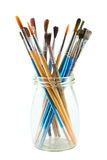 Art brushes. Different art brushes in a glass jar isolated on white background Stock Images