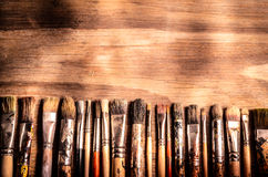 Art brushes. In front of a wooden background Stock Image