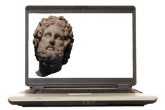The Art Of Business. Laptop with an ancient Greek bust expressing the concept of art and business Royalty Free Stock Image