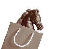 Art business. Cheap sculpture in a shopping bag Royalty Free Stock Images