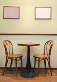 Art Cafe. Details of an interior of a small cafe. Just chairs, empty frames and tables Royalty Free Stock Images