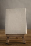 Art Canvas Easel in Portrait Orientation on Wood Plank Floor Stock Photos