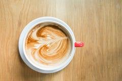 Art chaud de café sur la table en bois Photographie stock