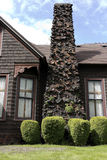 Art chimney. A street view of an ancient art chimney with different decorations and plants, located in Snohomish, Washington, USA Royalty Free Stock Photos