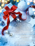 Art Christmas background with fir tree and gift box Royalty Free Stock Images