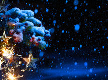 Art Christmas Background with ornaments and Christmas fir tree Stock Photos