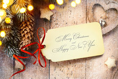 Art Christmas background with tree light and Christmas paper card Royalty Free Stock Image