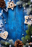 Art Christmas blue wooden background with snow fir tree and Chri Royalty Free Stock Photography